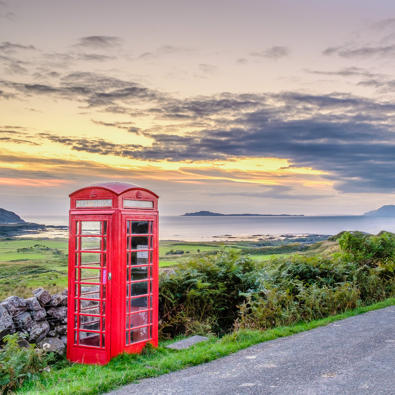 Souvenir photo coaster featuring an image of the red phone box at Kilmory with the north coast of Ardnamurchan and the Small Isles of Muck, Rùm and Eigg in the background | Ardnamurchan Scotland