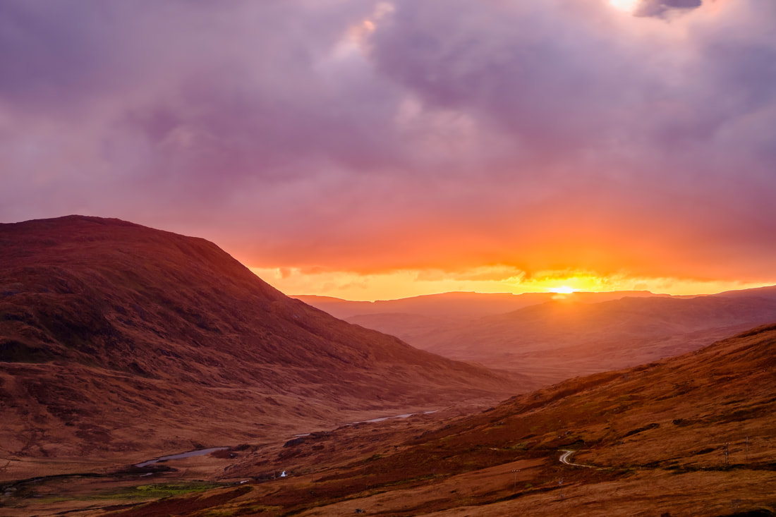 Gleann Dubh, the Black Glen, viewed from Taobh Dubh with the sun setting behind the hills beyond it | Morvern Scotland