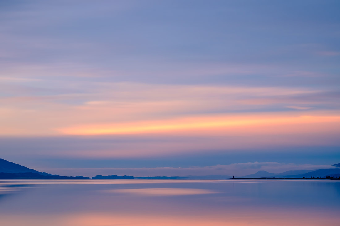 The colours from the last light of a winter sunrise painting the expansive waters of Loch Linnhe with pinks and blues | Ardgour Scotland