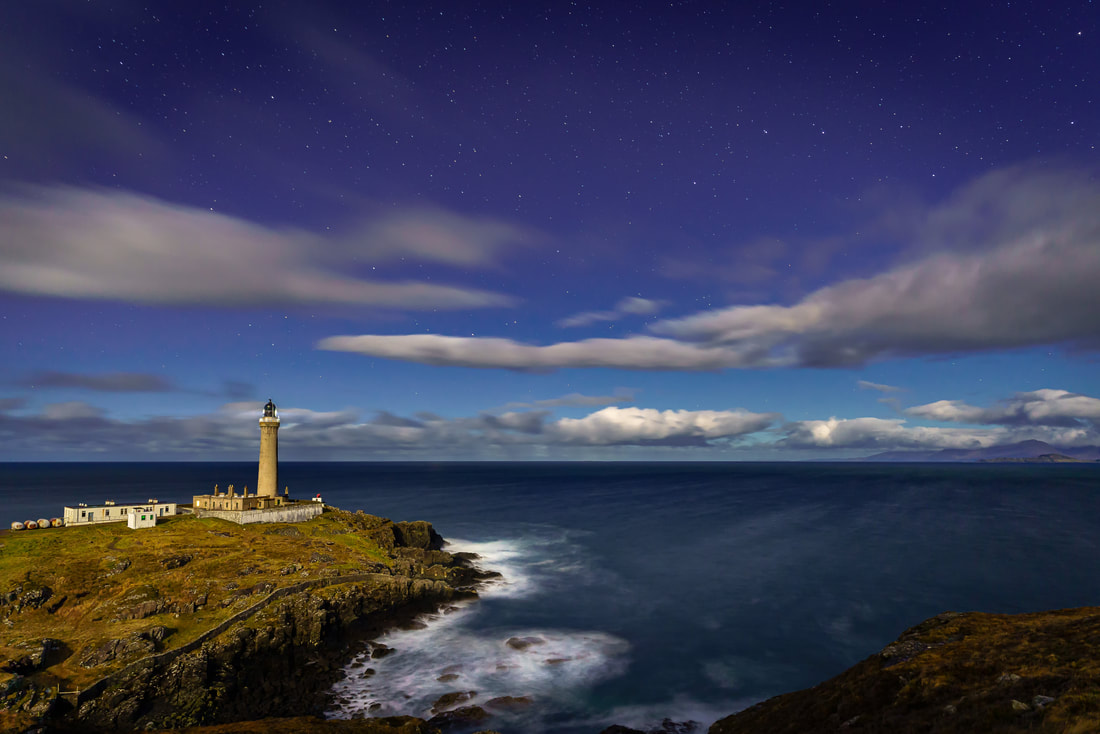Ardnamurchan Lighthouse lit up by the light moonlight with the stars of The Plough high in the sky above the Small Isles | Ardnamurchan Scotland