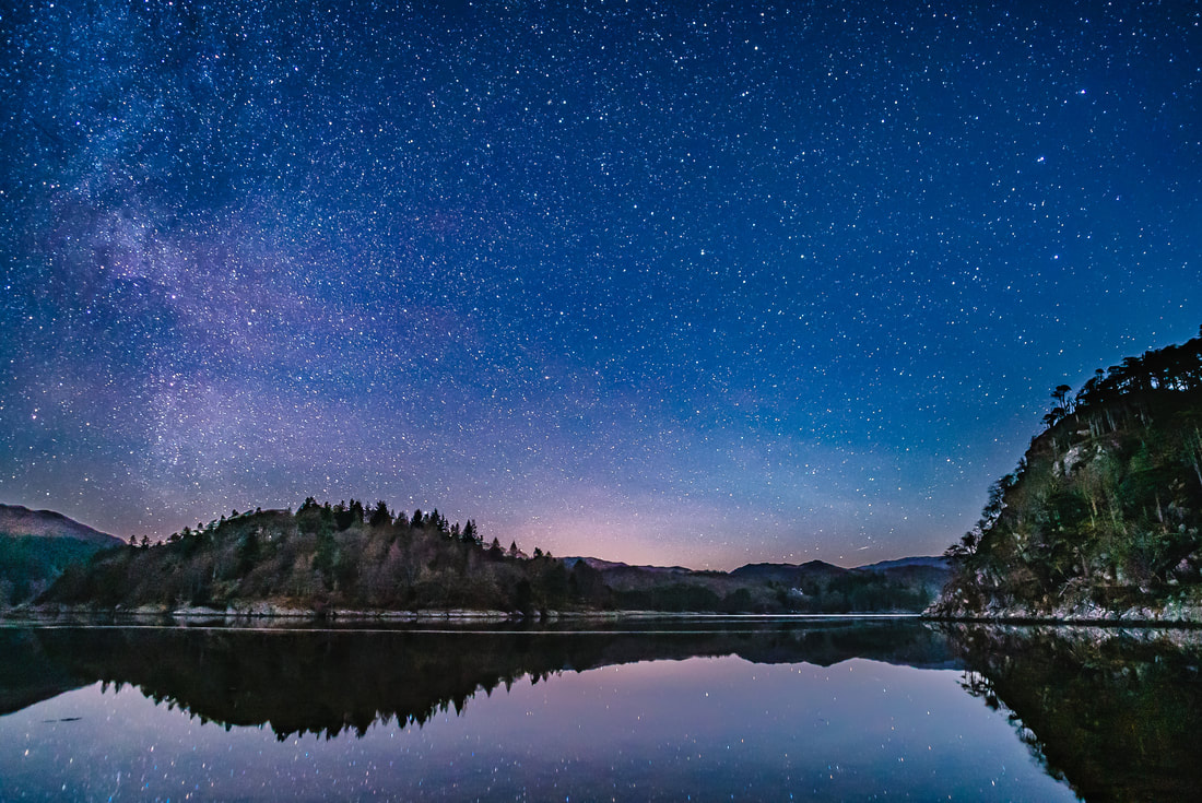 The stars reflected in the mirror-like waters of Loch Moidart on a still and clear night in January | Moidart Scotland